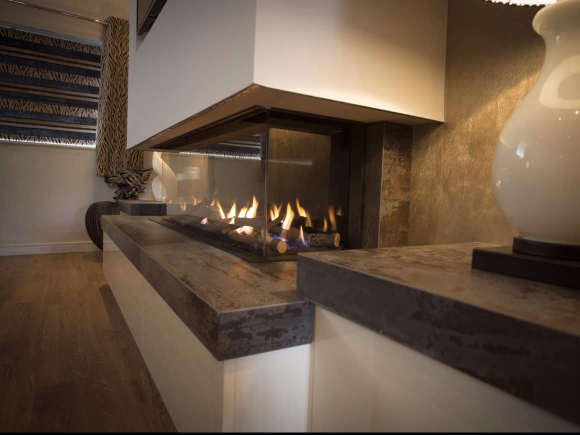 Image of Dekton Trilium Fireplace 4 in The welcoming warmth of home that only a fireplace can offer - Cosentino