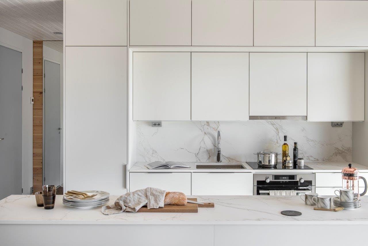 Image of Finnish wooden house Cosentino 2 1 in Finnish Wood House with Silestone® Bathroom and Dekton® Kitchen - Cosentino